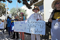 Members of the Peace Coalition of Monterey County at Wednesday's protest against war in Syria in front of the main post office in Salinas.The demonstration was in support of Congressman Sam Farr's stated antiwar position.