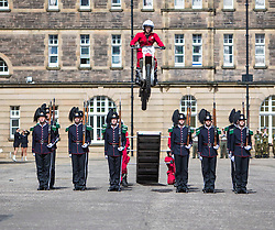 The 1,200 performers that will take part in the 2016 Royal Edinburgh Military Tattoo come together for the first time to rehearse.<br /> <br /> Pictured: The Imps jump over His Majesty The King's Guard from Norway
