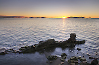 Sunset over Samish Bay and SanJuan Islands, from Clayton Beach in Larrabee State Park, Washington