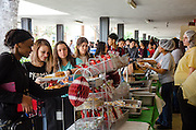 Scarborough High School students grab chips, cheeseburgers, and spicy chicken sandwiches during their tailgate party lunch.