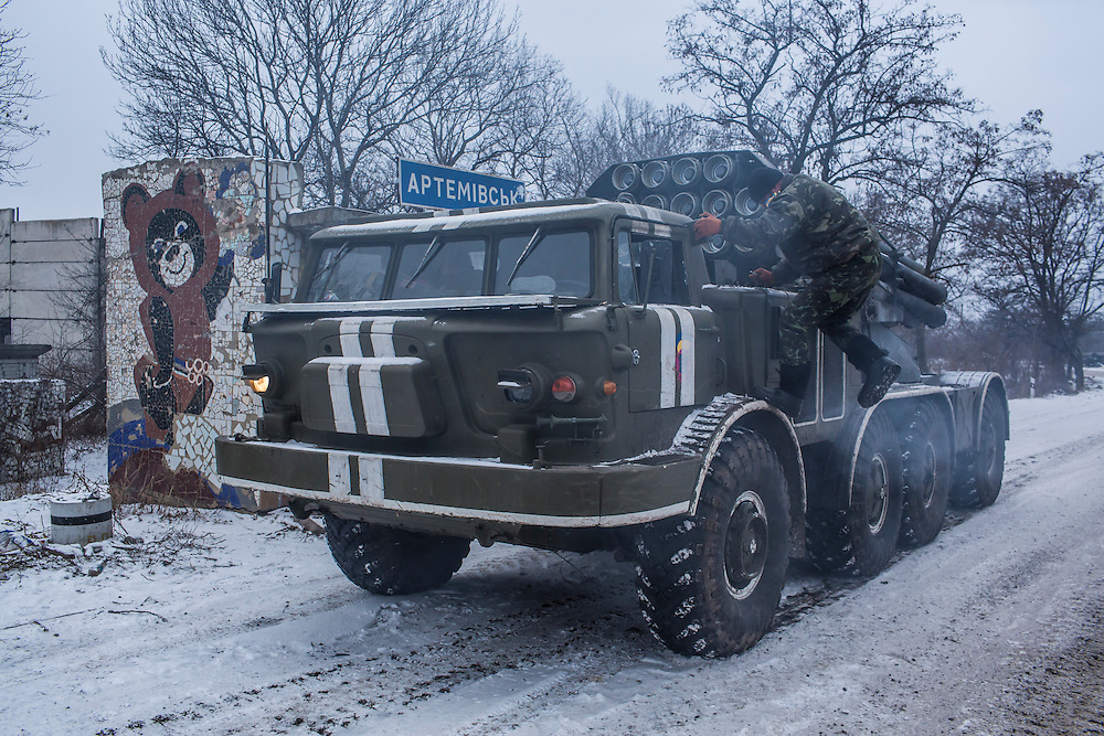 ARTEMIVSK, UKRAINE - FEBRUARY 16: A Ukrainian soldier aboard an Uragan self-propelled multiple rocket launcher prepares to drive in the direction of the embattled town of Debaltseve on February 16, 2015 in Artemivsk, Ukraine. A ceasefire that went into effect two days ago has been generally respected aside from Debaltseve, where pro-Russian rebels claim to have surrounded thousands of Ukrainian fighters and the battle continues. (Photo by Brendan Hoffman/Getty Images) *** Local Caption ***