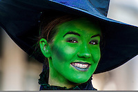Milan Williams, 16 of the Young Actors Stage in Sacramento, smiles as she portrays the witch from the Wizard of Oz, during the Santa Parade in Sacramento, Saturday December 14, 2013.<br /> Brian Baer/Special to the Bee