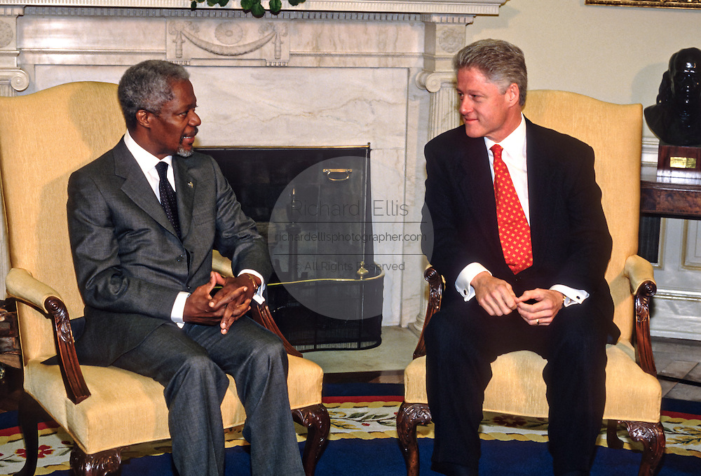US President Bill Clinton meets with UN Secretary General Kofi Annan in the Oval Office at the White House March 11, 1998 in Washington, DC.