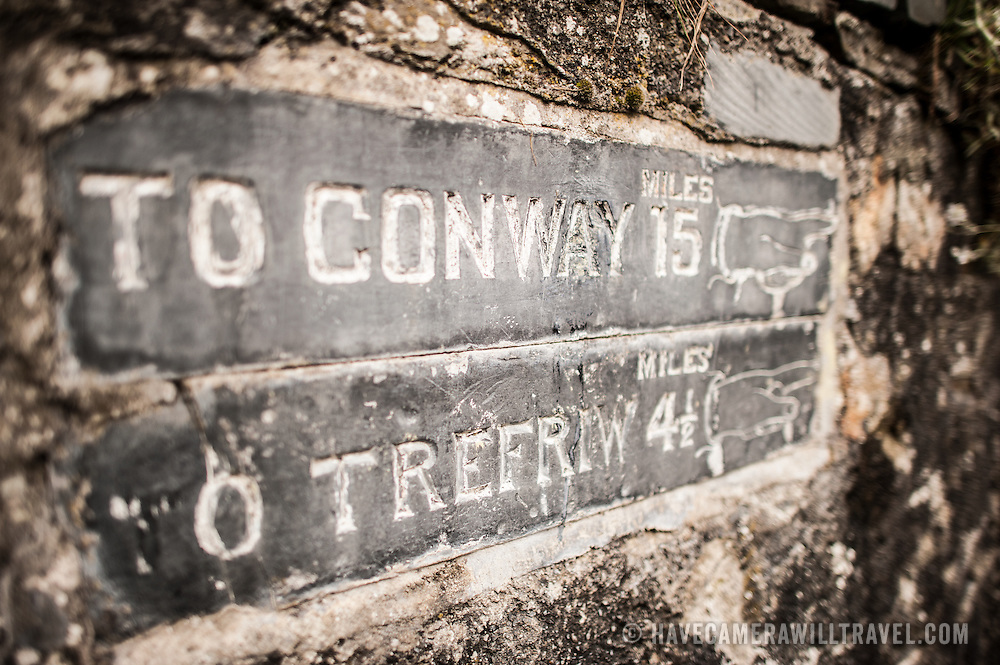 Betws-y-Coed Directions to Conwy Wales. An etched slate sign embedded into a stone wall in Betws-y-Coed providing directions to Conway (Conwy) and Trefreiw. In the heart of the Snowdonia National Park, the small village of Betws-y-Coed is a popular base for hikers heading into the surround mountains.