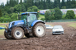 Mud and cars in the car park this morning. Sunday, 12th July 2015, day two at T in the Park 2015, at its new home at Strathallan Castle.