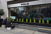 Two workmen polish the outside of Polo, a luxury cocktail bar at the Westbury Hotel on Conduit Street, on 8th March 2018, in London, England.
