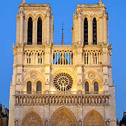 Notre Dame Cathedral, front view, in the evening with a clear blue sky
