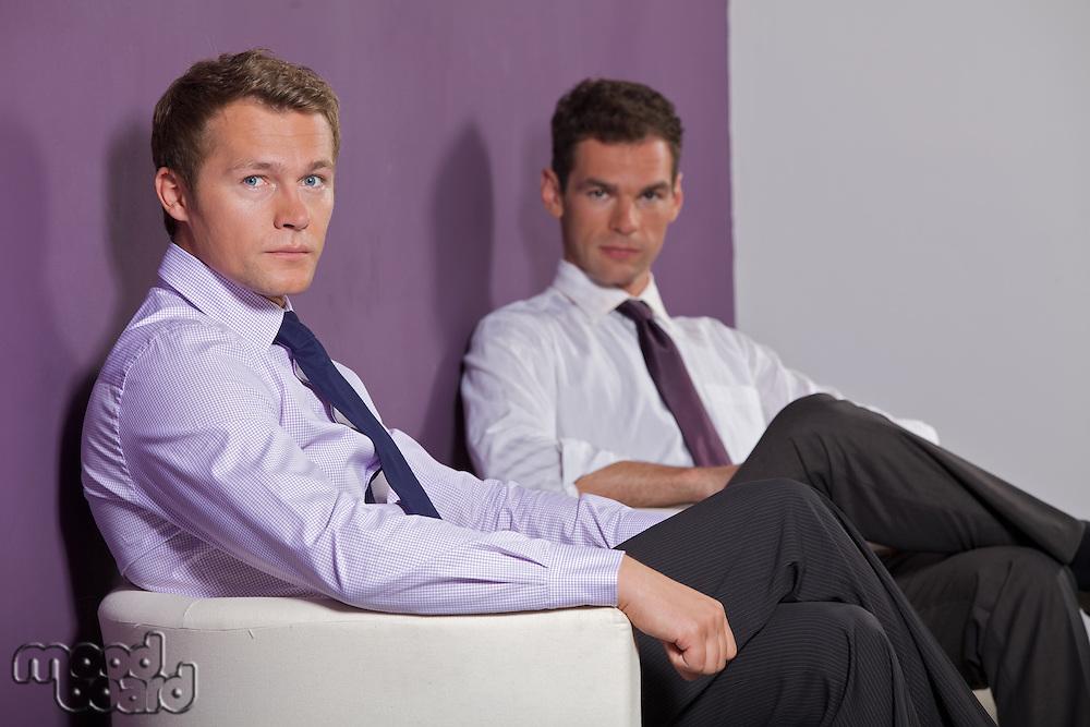 Portrait of businessmen sitting at office