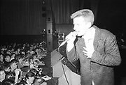 Suggs playing live with Madness, UK, 1980s