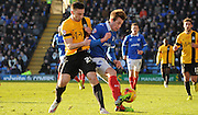 Adam Webster and Jake Cassidy battling for posession during the Sky Bet League 2 match between Portsmouth and Southend United at Fratton Park, Portsmouth, England on 24 January 2015. Photo by Michael Hulf.