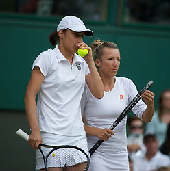LONDON, ENGLAND - Saturday, July 2, 2011: Kveta Peschke (CZE) and Katarina Srebotnik (SLO) in action during the Ladies' Doubles Final match on day twelve of the Wimbledon Lawn Tennis Championships at the All England Lawn Tennis and Croquet Club. (Pic by David Rawcliffe/Propaganda)
