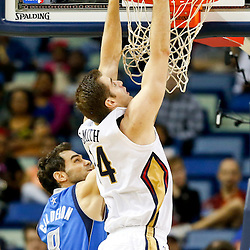 Dec 4, 2013; New Orleans, LA, USA; New Orleans Pelicans center Jason Smith (14) dunks over Dallas Mavericks point guard Jose Calderon (8) during the second quarter of a game at New Orleans Arena. Mandatory Credit: Derick E. Hingle-USA TODAY Sports