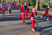 Happy to be nearing the finish - 2000 Santas of all ages take part in the annual Santa Run in Battersea Park to support Noah's Ark Children's Hospice.