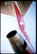 View from tarmac looking up at the tail of a TWA 727 jet at Lambert Intl Airport, St. Louis. Missouri