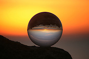 Crystal ball on a rock at Jekyll Island beach at sunrise or sunset.