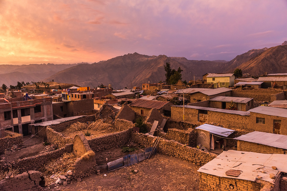 The village of Cabanaconde colors red at sunset, Colca Canyon, Peru.