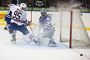 Marlies goaltender Jonathan Bernier stops a shot from Amerks forward Justin Bailey during a game in Rochester, New York, USA on Friday, December 4, 2015.