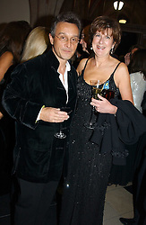 Fashion designer TOMASZ STARZEWSKI and the COUNTESS OF BALFOUR at The Magic of Winter ball in aid of the charity KIDS held at The Royal Courts of Justice, London on 2nd Ferbruary 2005.<br />