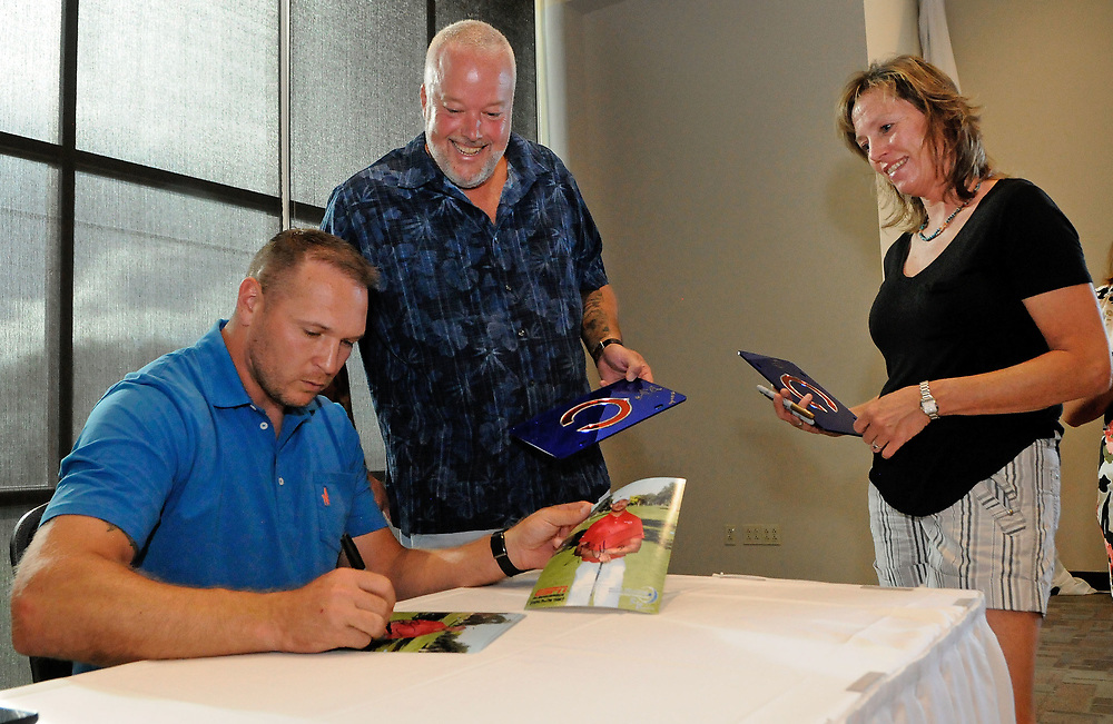 jt072617g/ sports/jim thompson/   Andy and Sue Hageman look on as Brian Urlacher  autographs some pictures and Chicago Bears murchandise at the VIP mixer after the Brian Urlacher Golf Tournament the the Canyon Club Golf course. July. 26, 2017. (Jim Thompson/Albuquerque Journal)