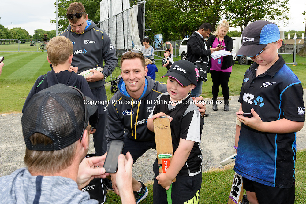Matt Henry of the Blackcaps poses with a young fan during a Blackcaps Barbecue at Hagley Oval in Christchurch, New Zealand. 14 November 2016. Photo: Kai Schwoerer / www.photosport.nz