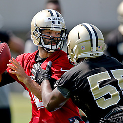 Jul 26, 2013; Metairie, LA, USA; New Orleans Saints quarterback Seneca Wallace is pressured by linebacker Eric Martin (55) during the first day of training camp at the team facility. Mandatory Credit: Derick E. Hingle-USA TODAY Sports