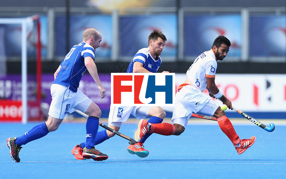 LONDON, ENGLAND - JUNE 15:  Manpreet Singh of India is watched by Gordan McIntyre (10) and Kenny Bain of Scotland (13) during the Pool B match between India and Scotland on day one of Hero Hockey World League Semi-Final at Lee Valley Hockey and Tennis Centreo n June 15, 2017 in London, England.  (Photo by Alex Morton/Getty Images)
