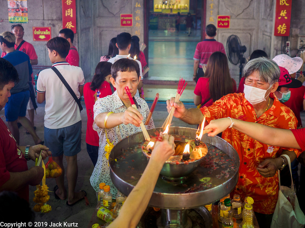 05 FEBRUARY 2019 - BANGKOK, THAILAND: People light Chinese New Year incense sticks at Wat Mangon Kamalawat, a large Chinese Buddhist temple in Bangkok's Chinatown. Chinese New Year celebrations in Bangkok started on February 4, 2019, although the city's official celebration is February 5 - 6. The coming year will be the Year of the Pig in the Chinese zodiac. About 14% of Thais are of Chinese ancestry and Lunar New Year, also called Chinese New Year or Tet is widely celebrated in Chinese communities in Thailand.      PHOTO BY JACK KURTZ