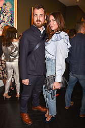 Lisa Snowdon and George Smart at a private view of work by Bradley Theodore entitled 'The Second Coming' at the Maddox Gallery, 9 Maddox Street, London England. 19 April 2017.