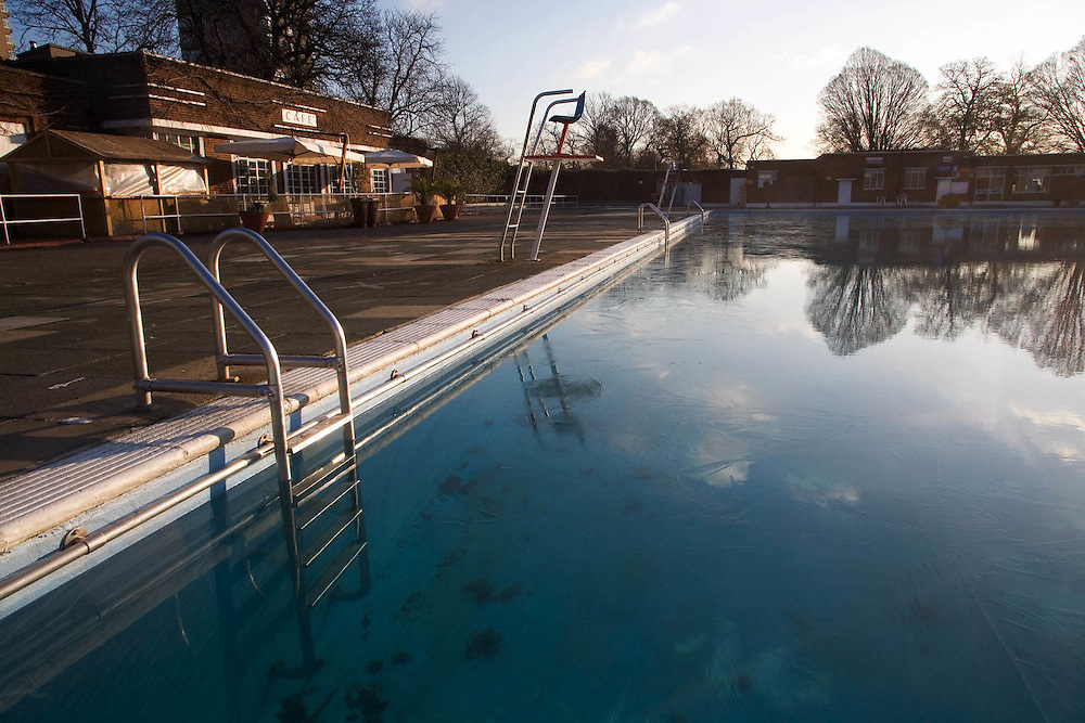 UK. London. Brixton Lido with a thin sheet of ice covering it before the traditional mid winter swim.