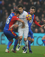 Football - 2016 / 2017 Premier League - Crystal Palace vs. Chelsea<br /> <br /> Cesc Fabregas of Chelsea is sandwiched between Joe Ledley and James McArthur at Selhurst Park.<br /> <br /> COLORSPORT/ANDREW COWIE