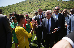 19.05.2015, Ramallah, PSE, FIFA Präsident Blatter besucht Palästina, im Bild der FIFA PRäsident Sepp Blatter bei seinem Palästina Besuch // FIFA president Joseph Blatter (R) shakes hands with Palestinian children during his visit to the sports club in the village of Dura al-Qaraa, near the West Bank city of Ramallah. Blatter hopes to head off a Palestinian call for a vote to expel Israel from football's governing body but that Israel must make a concession, Palestine on 2015/05/19. EXPA Pictures © 2015, PhotoCredit: EXPA/ APAimages/ Shadi Hatem<br /> <br /> *****ATTENTION - for AUT, GER, SUI, ITA, POL, CRO, SRB only*****