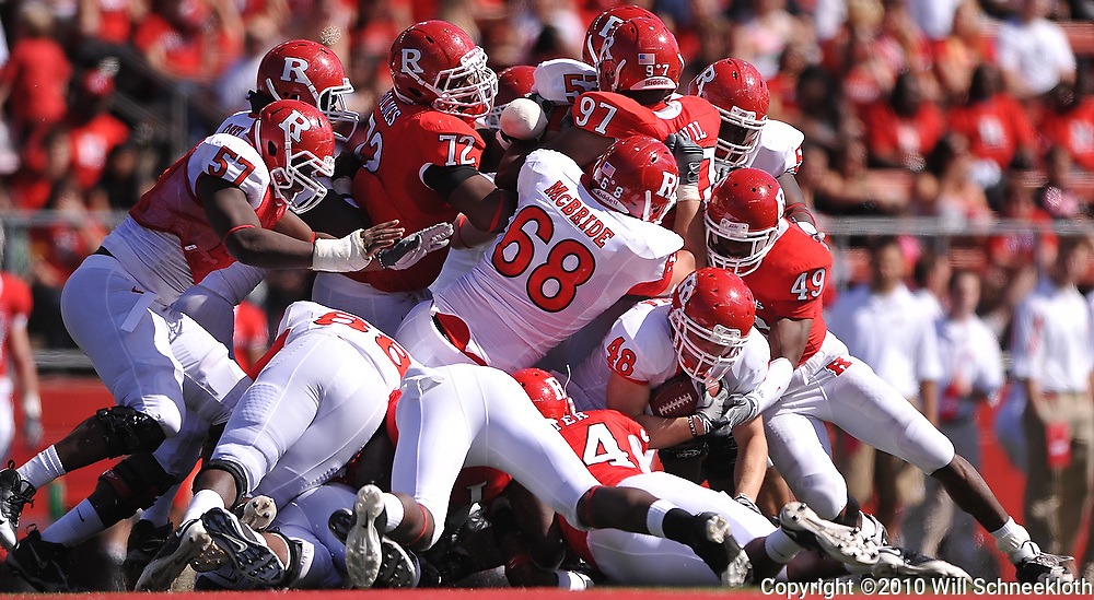 Apr 24, 2010; Piscataway, NJ, USA; White FB Nick Depaola (48) holds on to the ball at the bottom of a pile during Rutgers Scarlet and White intersquad NCAA football scrimmage at Rutgers Stadium. The Scarlet squad defeated the White, 16-7.