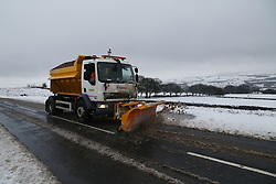 © Licensed to London News Pictures.04/03/16. Ilkley, UK.  A snow plough clears a road in Ilkley after heavy snowfall over night in Yorkshire caused chaos on many roads. Forecasters are predicting more cold weather this week as Storm Jake takes hold. Photo credit : Ian Hinchliffe/LNP