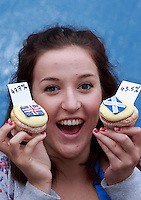 Pippa Perriam who works in the Cuckoo's bakery holding cupcakes.<br /> Cupcakes referendum photocall to take place. Cuckoo's bakery has been selling Yes, No and undecided cupcakes since March .<br /> Pako Mera/Universal News And Sport (Europe) 17/09/2014