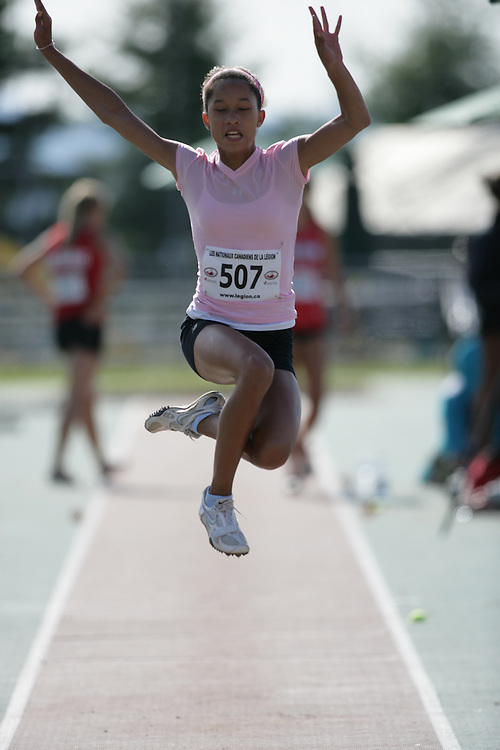 (Sherbrooke, Quebec -- 8 Aug 2009)  Christian Brennan of Unattached-OTFA competes in girls under-17 (youth) long jump at the 2009 Royal Canadian Legion National Youth track and field championships. Photograph copyright Sean Burges / Mundo Sport Images  2009.