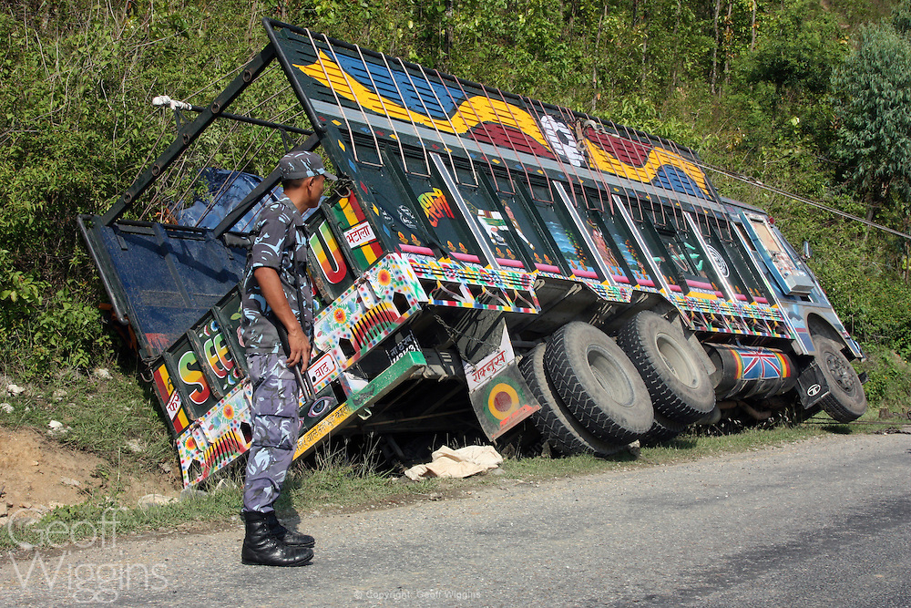 Police guard Nepali heavy goods trucks involved in road accidents Highway 1 Nepal