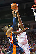 FAYETTEVILLE, AR - DECEMBER 19:  DeMarc Richardson #15 of the UT Martin Skyhawks has his shot blocked by Coty Clarke #4 of the Arkansas Razorbacks at Bud Walton Arena on December 19, 2013 in Fayetteville, Arkansas.  The Razorbacks defeated the Skyhawks 102-56.  (Photo by Wesley Hitt/Getty Images) *** Local Caption *** DeMarc Richardson; Coty Clarke