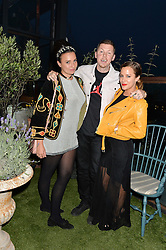 Left to right, GIZZI ERSKINE, PROFESSOR GREEN and CAROLINE FLACK at the Warner Music Group & GQ Summer Drinks hosted in asociation with Quintessentially at Shoreditch House, Ebor Street, London on 6th July 2016.