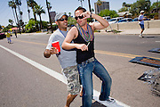 14 APRIL 2007 -- PHOENIX, AZ: Men dance in the annual Gay Pride Parade in Phoenix, AZ. Thousands of people attended the annual event. Photo by Jack Kurtz / ZUMA Press