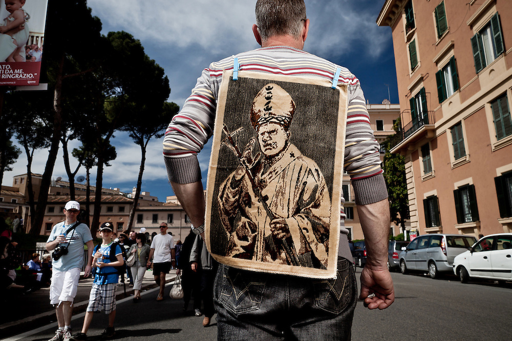 An illegal vendor of souvenirs depicting John Paul II is seen near St. Peter's Square. On 1 May 2011, six years and one month after his death, Pope John Paul II was beatified by his successor Benedict XVI..It is estimated that over one half million people have taken part in the ceremony which was held in St. Peter's Square, the largest crowd in Rome since his funeral. .This is considered the fastest beatification in Church history, the Vatican will have to attribute another miracle to John Paul's intercession after the beatification, only in this case he will be declared a saint.
