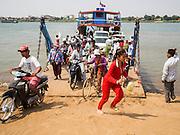 "26 FEBRUARY 2015 - PHNOM PENH, CAMBODIA: Passengers get off a ferry on Koh Dach (""Silk Island"") on the Mekong River near Phnom Penh.    PHOTO BY JACK KURTZ"