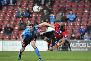 Calvin Andrew diving header during the EFL Sky Bet League 1 match between Scunthorpe United and Rochdale at Glanford Park, Scunthorpe, England on 14 March 2017. Photo by Daniel Youngs.