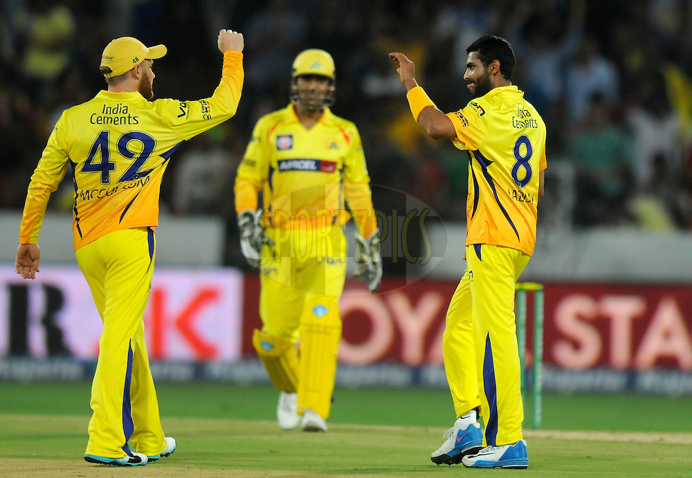 Ravindra Jadeja of Chennai Super Kings celebrates the wicket of Suryakumar Yadav of Kolkata Knight Riders during match 1 of the Oppo Champions League Twenty20 between the Kolkata Knight Riders and the Chennai Superkings held at the Rajiv Gandhi Cricket Stadium, Hyderabad, India on the 17th September 2014<br /> <br /> Photo by:  Pal Pillai / Sportzpics/ CLT20<br /> <br /> <br /> Image use is subject to the terms and conditions as laid out by the BCCI/ CLT20.  The terms and conditions can be downloaded here:<br /> <br /> http://sportzpics.photoshelter.com/gallery/CLT20-Image-Terms-and-Conditions-2014/G0000IfNJn535VPU/C0000QhhKadWcjYs