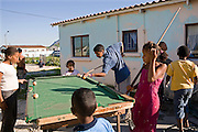 Children play pool outside a house on the Lavender Hill township of Cape town, South Africa.