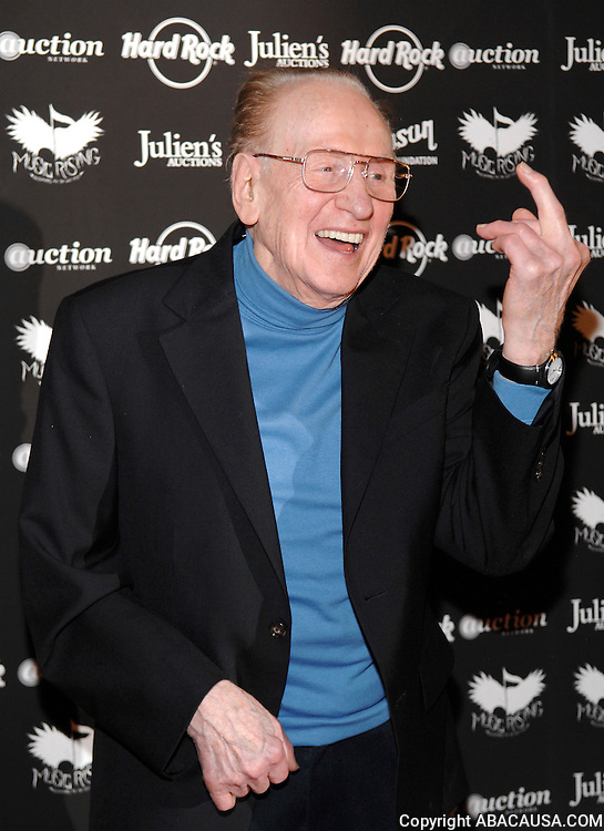 Legendary guitarist Les Paul poses at the Icons of Music II Auction to benefit Music Rising at the Hard Rock Cafe in Times Square New York City, USA on May 31, 2008.
