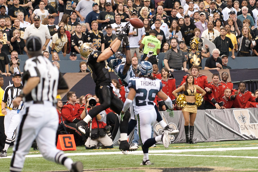 21 November 2010: New Orleans Saints quarterback Drew Brees (9) throws a pass to New Orleans Saints tight end Jimmy Graham (80) but drops ball at in during the first half of the game. New Orleans Saints leads Seattle Seahawks 27 -16 at first half.