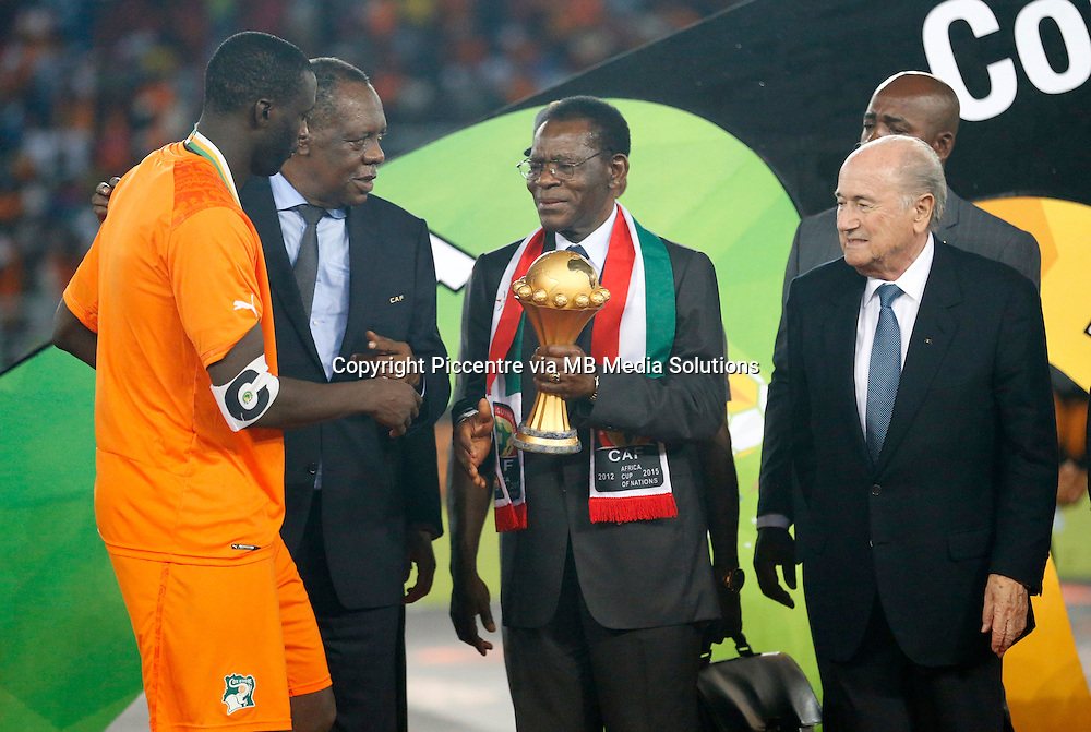 Equatorial Guinea President Teodoro Obiang Nguema Mbasogo (C) and Fifa President Sepp Blatter (R  presents a trophy to Ivory Coast Captain Yaya Toure after defeating Ghana during their Africa Cup of Nations finals soccer at the Estadio de Bata Equatorial Guinea, on February 8th, 2015. Ivory Coast won 9-8 on post Penalties. (Photo/Mohammed Amin/www.pic-centre.com)