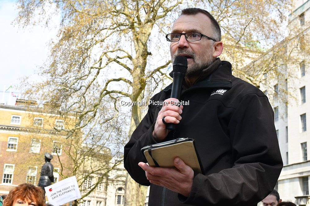 Speaker Eduardo Goncalves - Founder - Campaign to Ban Trophy Hunting rally at the 5th Global March for Elephants and Rhinos march against extinction and trophy hunting murdering and killing animals for blood spots and ivory trade outside downing street on 13 April 2019, London, UK.