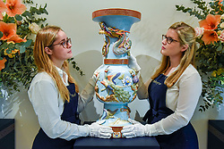 "© Licensed to London News Pictures. 22/11/2019. LONDON, UK. Technicians present ""An important and rare vase"", 1898, Imperial Porcelain Factory, St. Petersburg, period of Nicholas II  (Est. GBP40-60k) at the preview for the upcoming sales of Russian artworks at Sotheby's New Bond Street.  The Russian Pictures and Works of Art, Fabergé and Icons sales take place on 26 November.  Photo credit: Stephen Chung/LNP"