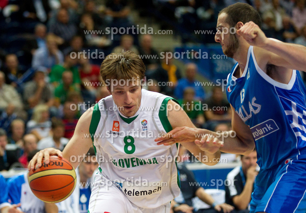 Matjaz Smodis of Slovenia vs Kostas Koufos of Greece during basketball game between National basketball teams of Slovenia and Greece at FIBA Europe Eurobasket Lithuania 2011, on September 8, 2011, in Siemens Arena,  Vilnius, Lithuania. Greece defeated Slovenia 69-60.  (Photo by Vid Ponikvar / Sportida)